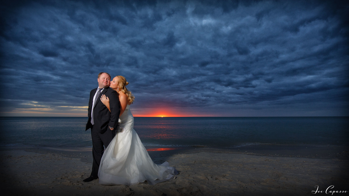 naples wedding photographer works with couple at sunset